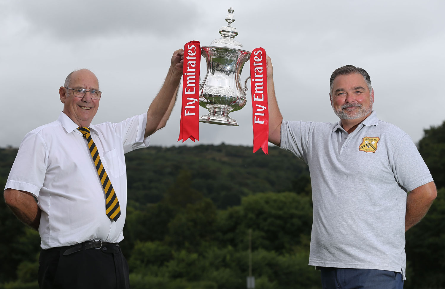 Cheddar AFC with FA Cup  LtoR Donald White (President) and Matt Postins (Chairman),        Cheddar AFC Double Prize Money Activity, Cheddar, UK - 22 Aug 2018  Photo: Martin Bennett for The FA